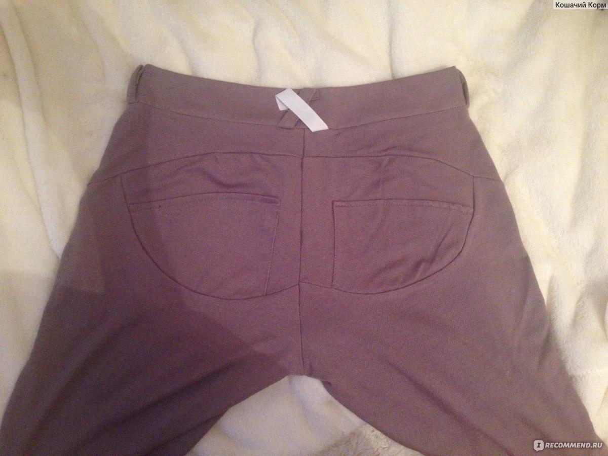 Фото женских поп в брюках 14 фотография